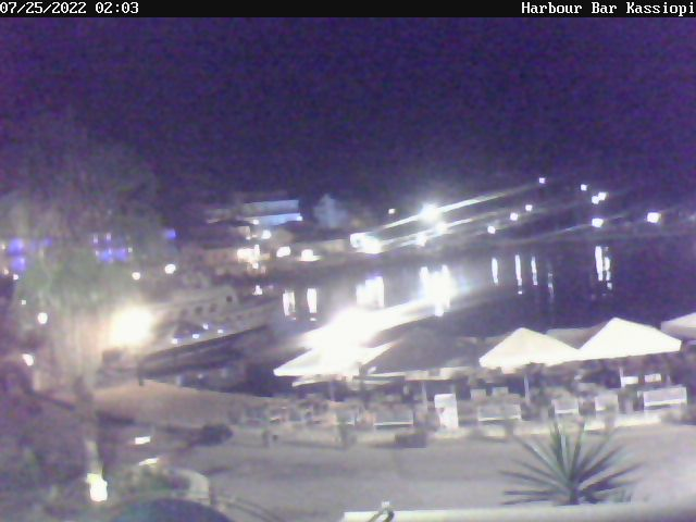 Live view of Kassiopi harbour, by the Harbour Bar.